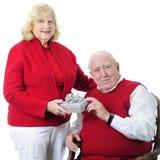Gåva-dela pensionärer Arkivbild