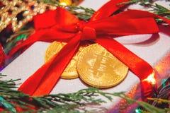 Gåva för jul eller bitcoin för nytt år Fotografering för Bildbyråer
