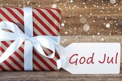 Gåva med snöflingor, textguden Juli betyder glad jul Arkivfoton