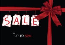 Gåva som ger den Black Friday försäljningsetiketten med det röda bandet Stock Illustrationer