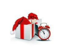 Gåvaaskar med Santa Hat och klockan Arkivbild