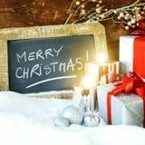 Gåvaboses och stearinljus för jul Fotografering för Bildbyråer