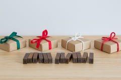 Gåvor och `en för glad jul för ord`, Royaltyfri Bild