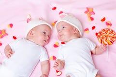 Gêmeos e doces Imagens de Stock Royalty Free