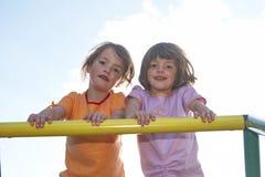 Gêmeos no pólo de escalada 01 Imagens de Stock Royalty Free