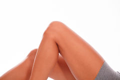 Górne kobiet nogi na białym tle Obrazy Royalty Free