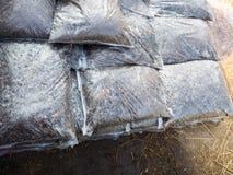 Gödningsmedel i plastpåsarna Royaltyfri Bild