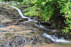 Gömd vattenfall i träna Royaltyfria Foton
