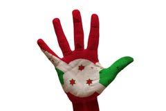 gömma i handflatan flaggan Burundi arkivbilder