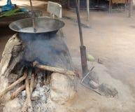 Gömma i handflatan sockerproduktion royaltyfri foto