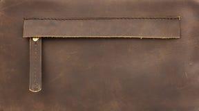 Gömt zippered fack på naturligt brunt läder Arkivbilder