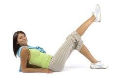gör den klädda övningssportkvinnan Royaltyfri Fotografi