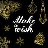 Gör en önska! Räcka utdragna grafiska beståndsdelar och bokstäver i guld-/svartfärger Royaltyfri Fotografi