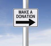 Gör en donation arkivbilder