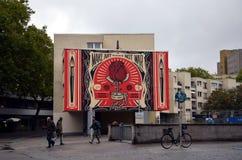` Gör konst - inte krig`-grafitti Arkivfoto