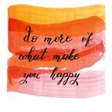 Gör mer av vad gör dig lycklig, handen dragen bokstäver på waterco Arkivfoton