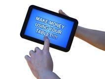 gör pengar att tablet att använda som är ditt Arkivfoton