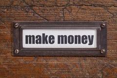 Gör pengar - etikett för mappkabinett Arkivfoton
