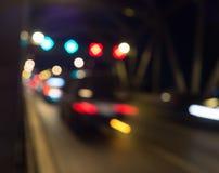 Gör suddig abstrakt bokeh av bakgrund för ljus för gatastadsnatten Arkivfoton