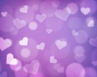 Gör suddig bakgrund med förälskelsetemat - hjärtor och ljusa orbs - lilor Royaltyfria Foton