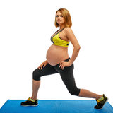 göra den gymnastiska gravid kvinna för övningar royaltyfri fotografi