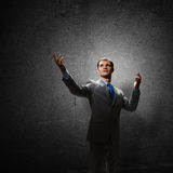 Göra en gest affärsmannen Arkivbild