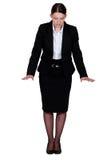 Göra en gest för affärskvinna. arkivbilder