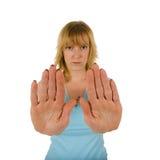 göra en gest stoppkvinnabarn Arkivfoton