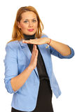 Göra en gest tid för affärskvinna ut Royaltyfri Foto