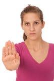 göra en gest tonårs- flickateckenstopp Royaltyfri Foto