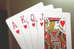 Göra ett ess på, göra till kung, göra till drottning, stålar av höga kort för hjärta i rad Fotografering för Bildbyråer