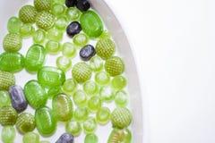 Göra grön julgodisen Arkivbild