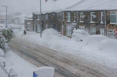Göra klar en bana under en snöstorm Royaltyfri Bild