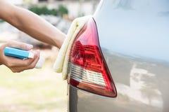 Göra ren bilen Arkivfoto