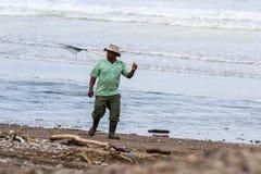 Göra ren upp stranden Fotografering för Bildbyråer