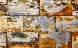 Göra sammandrag anfrätt färgrik rostig bakgrund, gammal väggtextur Arkivbilder