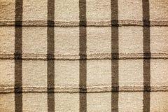 Gęsty wyplata pasiastego dywanika na podłoga obrazy stock