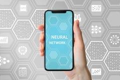 Głęboki neural sieci pojęcie Ręka trzyma nowożytnego bezel bezpłatnego mądrze telefon przed neutralnym tłem z ikonami fotografia royalty free