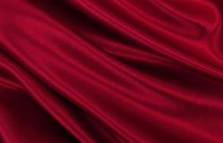 Gładzi elegancką czerwoną jedwabiu lub atłasu luksusową sukienną teksturę jako abstrac Zdjęcia Royalty Free