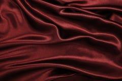 Gładzi elegancką czerwoną jedwabiu lub atłasu luksusową sukienną teksturę jako abstrac Zdjęcie Stock