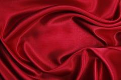 Gładzi elegancką czerwoną jedwabiu lub atłasu luksusową sukienną teksturę jako abstrac Zdjęcie Royalty Free