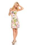 głos Piękna blondynka w ślicznej sukni fotografia stock