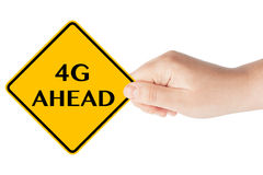 4G Ahead traffic sign in woman's hand. On a white background Royalty Free Stock Photos