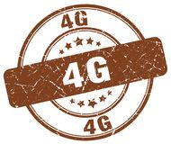 4g brown stamp. 4g brown grunge round stamp isolated on white background Stock Photo
