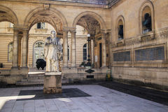 G. Bude statue. At College de France near the Sorbonne in Paris Royalty Free Stock Image