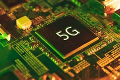 5g chip closeup on motherboard. stock photo