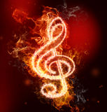 G Clef in Fire. On red and black background Royalty Free Stock Photography