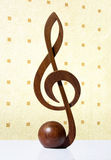G-clef icon carved from wood Stock Photo