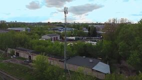 5 g communication tower for transmitting communication signals on the outskirts of the city industrial zone
