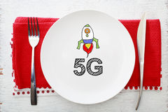 5G concept on white plate with fork and knife. On red napkins Stock Photography